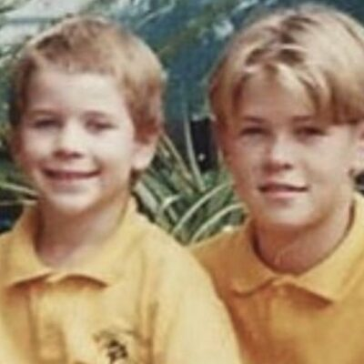 A photo of Chris and Liam Hemsworth as children wearing yellow shirts