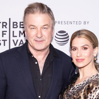 Alex Baldwin on the left, Hilaria on the right, standing together at a film festival.