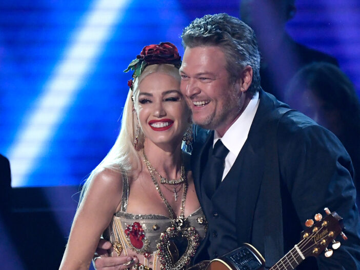Gwen Stefani cheek-to-cheek with Blake Shelton, on stage together.