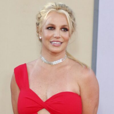 Britney Spears smiling in a red dress
