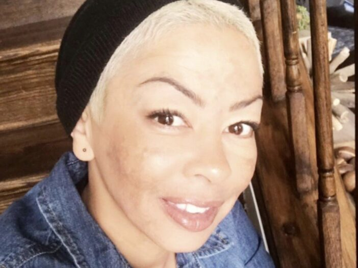 Close up of Wanda Hutchins in a jean jacket and black beanie posted to her Wandaful Home Designs Instagram account.