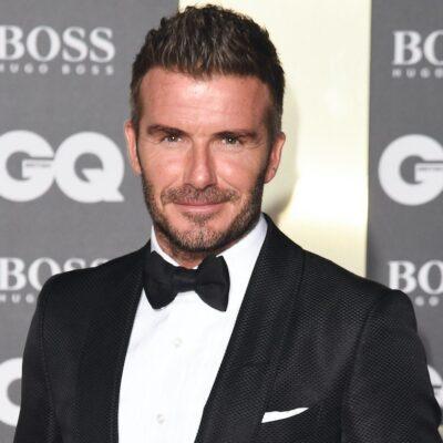 David Beckham smiling in a tuxedo