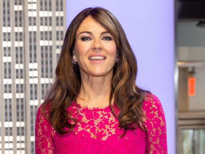 Elizabeth Hurley attends a breast cancer awareness event in a bright pink dress