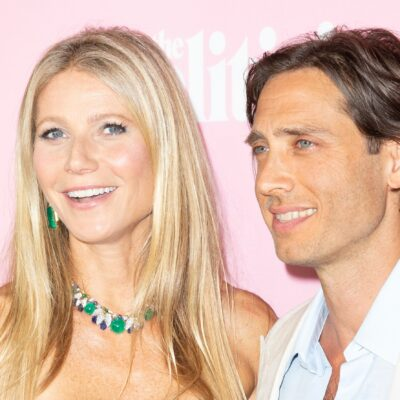 Gwyneth Paltrow smiling on the left, Brad Falchuk smiling on the right.