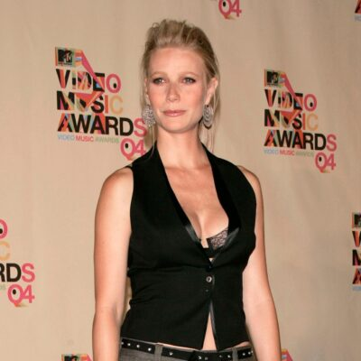 Gwyneth Paltrow wears a black vest with no shirt underneath at an MTV Movie Awards event