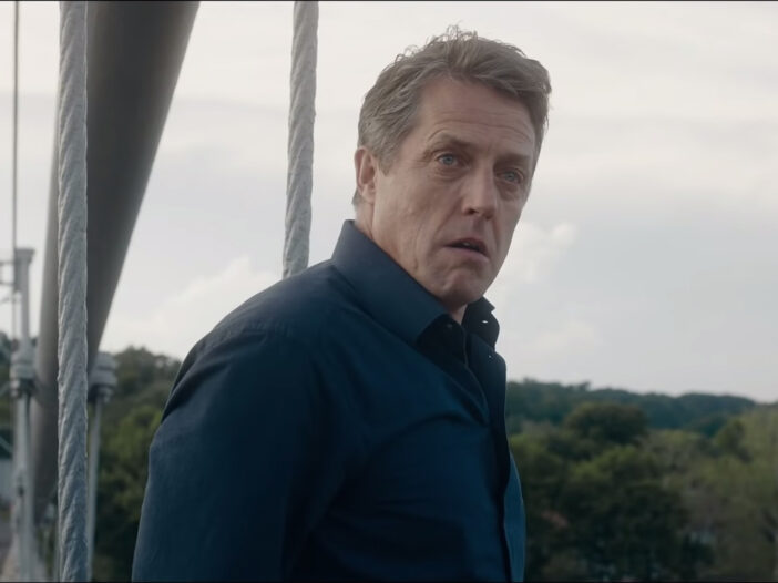 Screenshot from 'The Undoing' of Hugh Grant looking distraught and about to jump off a bridge.