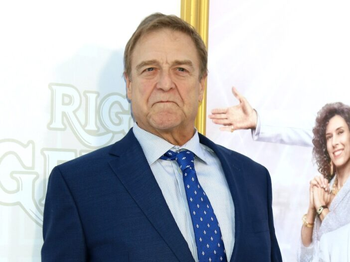 John Goodman in a suit at a Might Gemstones event