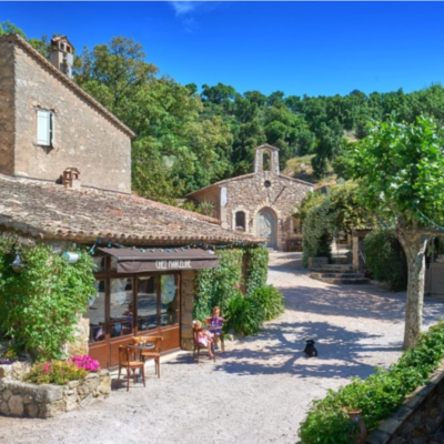 Stone buildings line a walkway in a French village