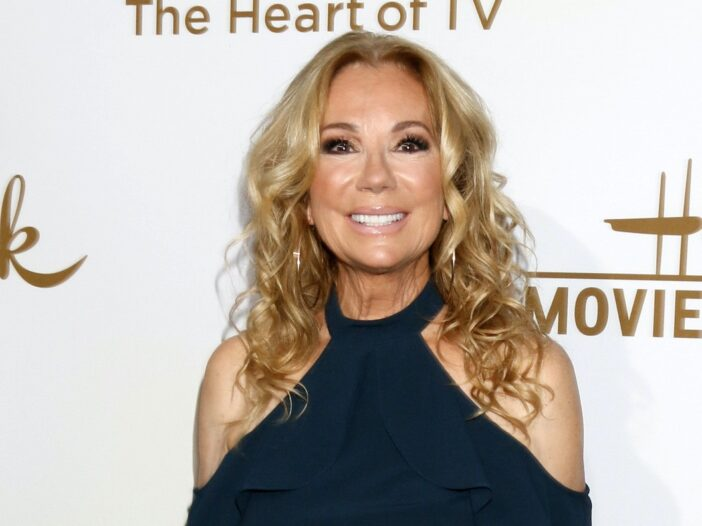 Kathie Lee Gifford smiling in a dark green dress at a Hallmark event