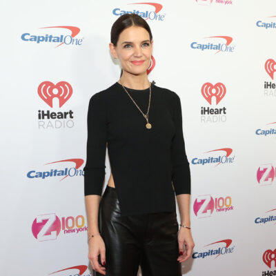 Katie Holmes wearing leather pants and a black top