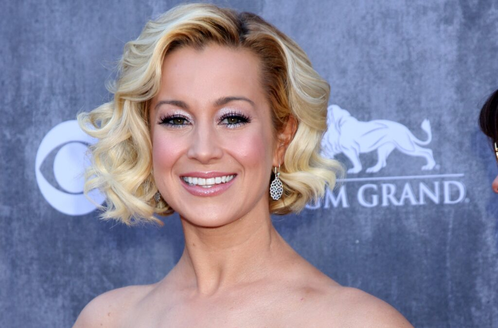 Kellie Pickler in a strapless dress with a wavy bob at the Academy of Country Music Awards.
