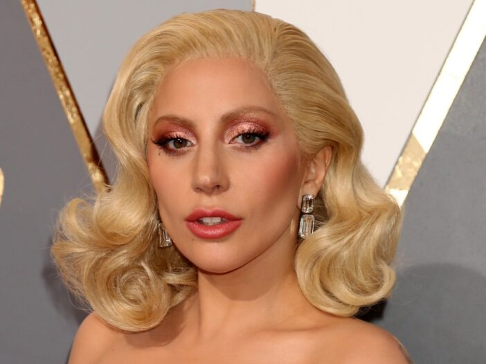Lady Gaga wears a white strapless dress to the Oscars
