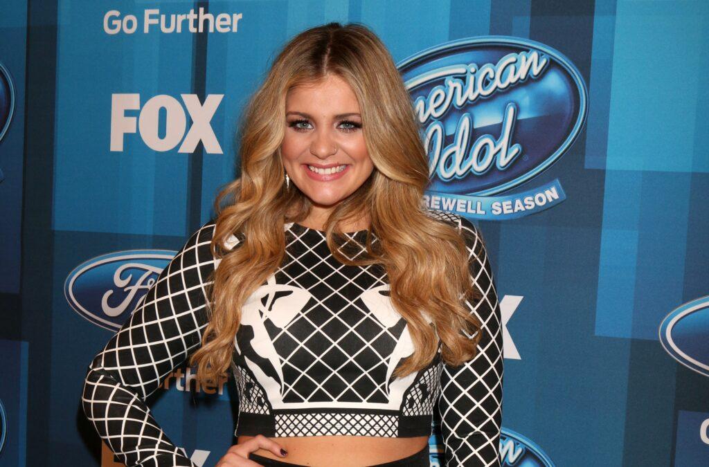 Lauren Alaina in a black and white printed crop top and loose waves at the 'American Idol' finale.
