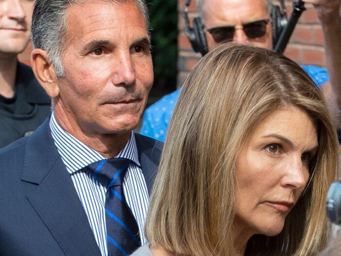 Mossimo Giannulli and Lori Loughlin exiting court.