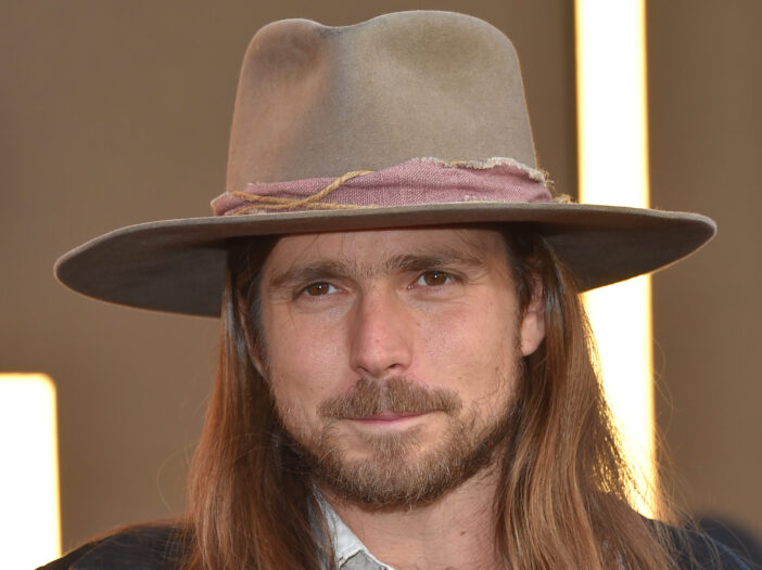Lukas Nelson at the 'A Star Is Born' LA premiere in a tan hat.