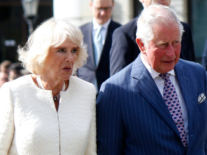 Prince Charles in a blue suit with Camilla Parker Bowles in a white outfit