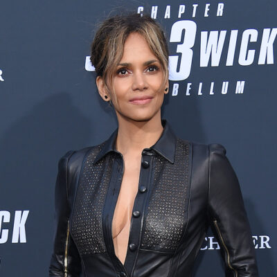 Halle Berry smiling in a black leather outfit