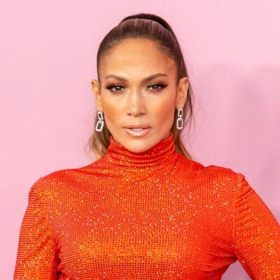 Jennifer Lopez in an orange dress