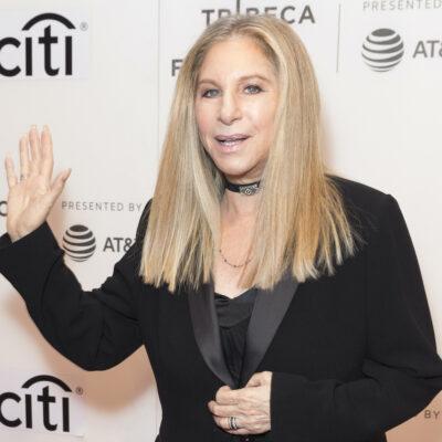 Barbra Streisand smiling and waving