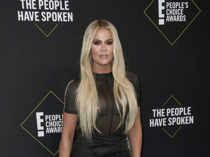 Khloe Kardashian in a black dress and platinum blond hair at the People's Choice Awards.