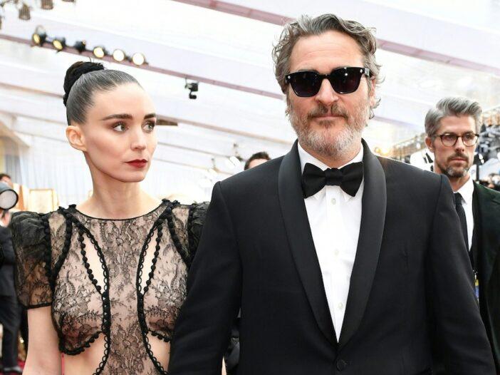 Joaquin Phoenix in a tuxedo with Rooney Mara in a sheer dress