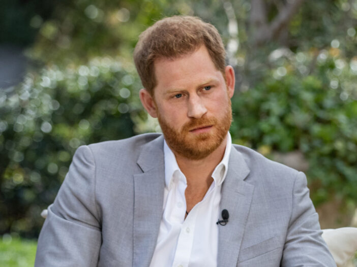 Prince Harry in a grey suit during Oprah's interview