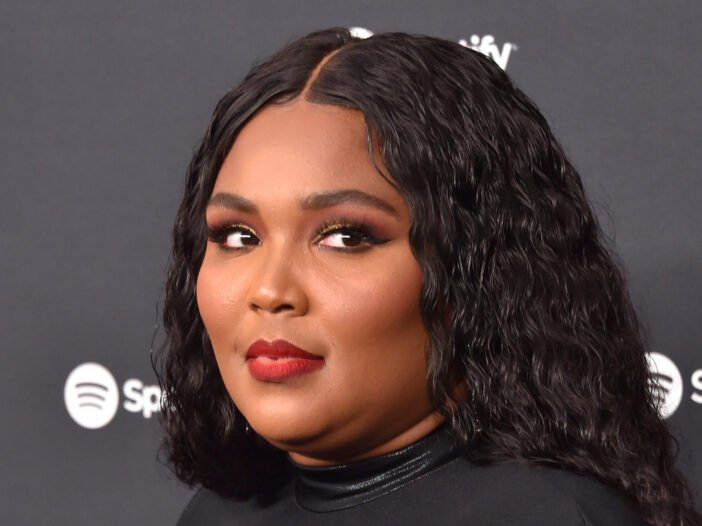 Lizzo wearing a black dress at the Spotify Best New Artist 2020 party