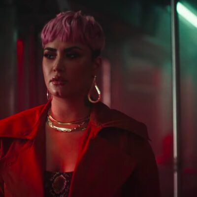 screenshot of Demi Lovato in a red jacket