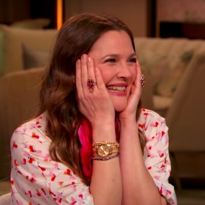 screenshot of Drew Barrymore with her hands on her face on the Drew Barrymore Show