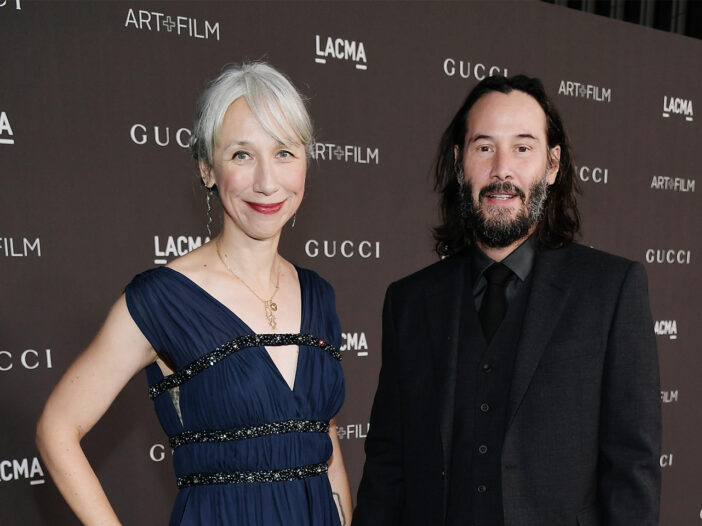 Alexandra Grant on the left, standing with Keanu Reeves.
