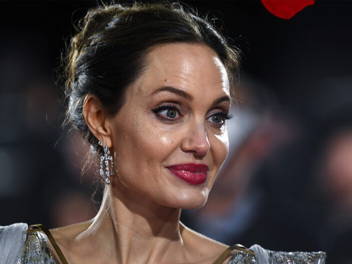 Close up of Angelina Jolie looking surprised.