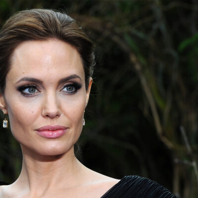 Close up of Angelina Jolie looking serious.
