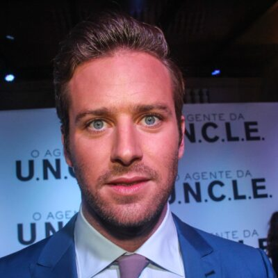 Armie Hammer wears a blue suit while walking the red carpet