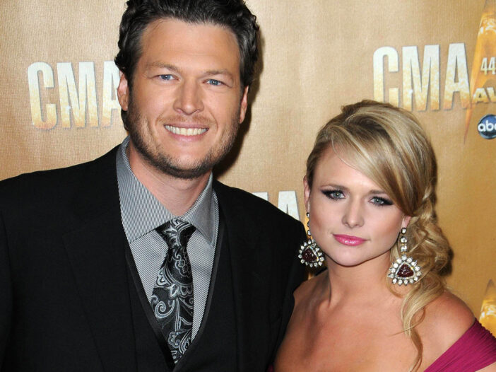 Blake Shelton on the left, smiling, Miranda Lambert on the right, looking annoyed.
