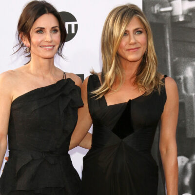 Courteney Cox and Jennifer Aniston together at a red carpet event, in black dresses