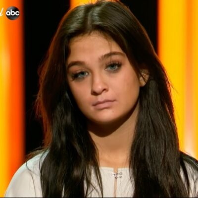 Claudia Conway stands onstage as she awaits the judges decision on American Idol