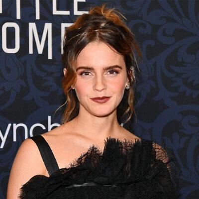 Emma Watson in a black dress at a movie premiere.