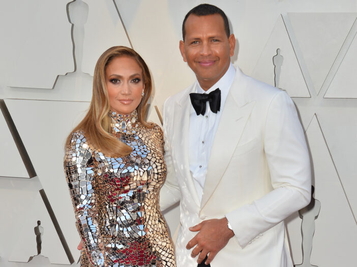 Jennifer Lopez on the left, standing with Alex Rodriguez.