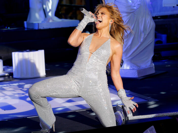 Jennifer Lopez on one knee, performing in Times Square on New Years Eve 2021