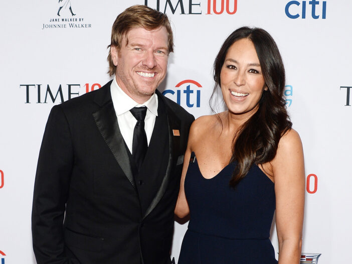 Chip Gaines on the left, standing with Joanna Gaines, both in formal wear.