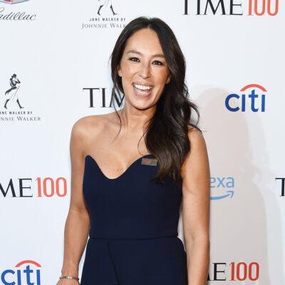 Joanna Gaines smiling in a black dress.