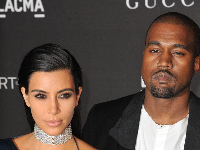 Kim Kardashian and Kanye West looking serious.