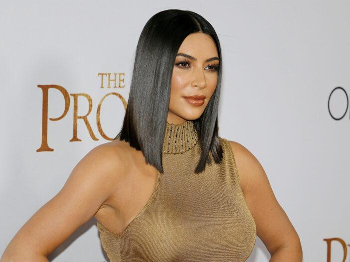 Kim Kardashian looking fierce in a gold dress.