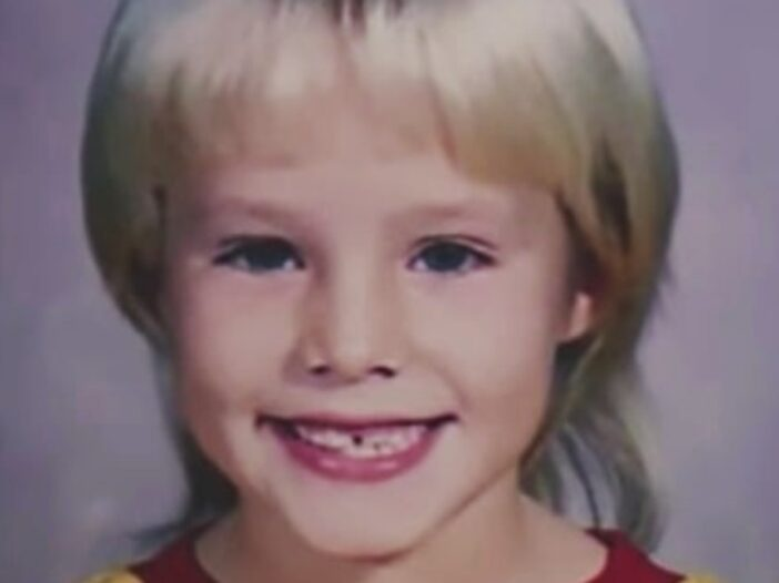 A childhood photo of Kristen Bell with her hair styled in a mullet
