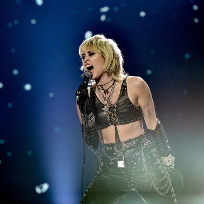 Miley Cyrus in black leather performing on New Year's Eve 2021.