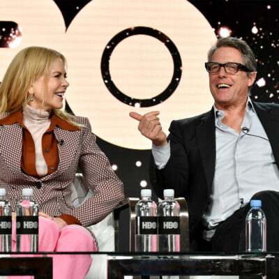Nicole Kidman and Hugh Grant laughing together at a press event for HBO