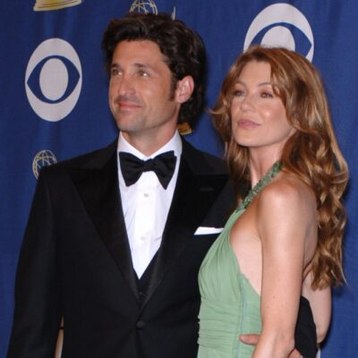 Patrick Dempsey, in a black tux, poses with Ellen Pompeo, in a green dress