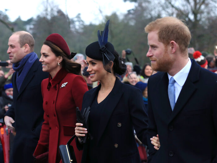From left to right: Prince William, Kate Middleton, Meghan Markle, Prince Harry, walking together on a cold day.