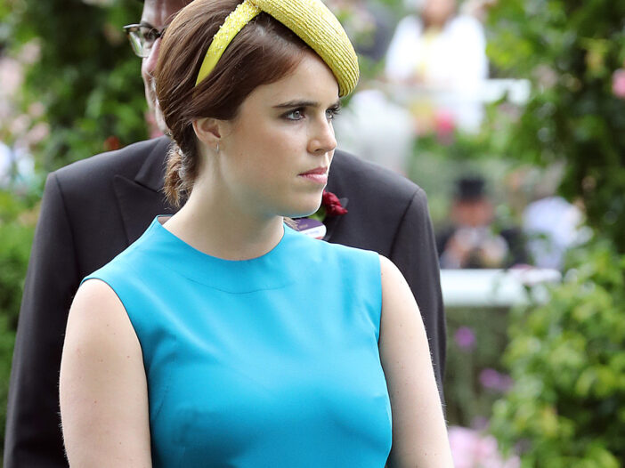 Princess Eugenie in a yellow hat and blue dress