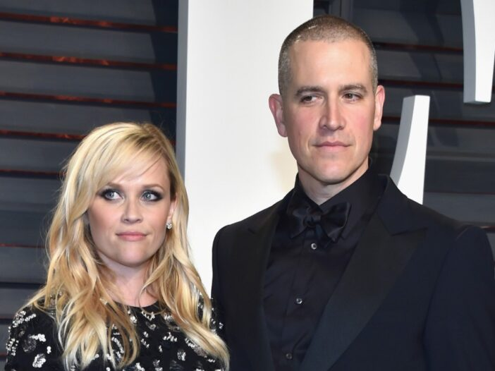 Reese Witherspoon and Jim Toth, both dressed in black, at an Oscar party